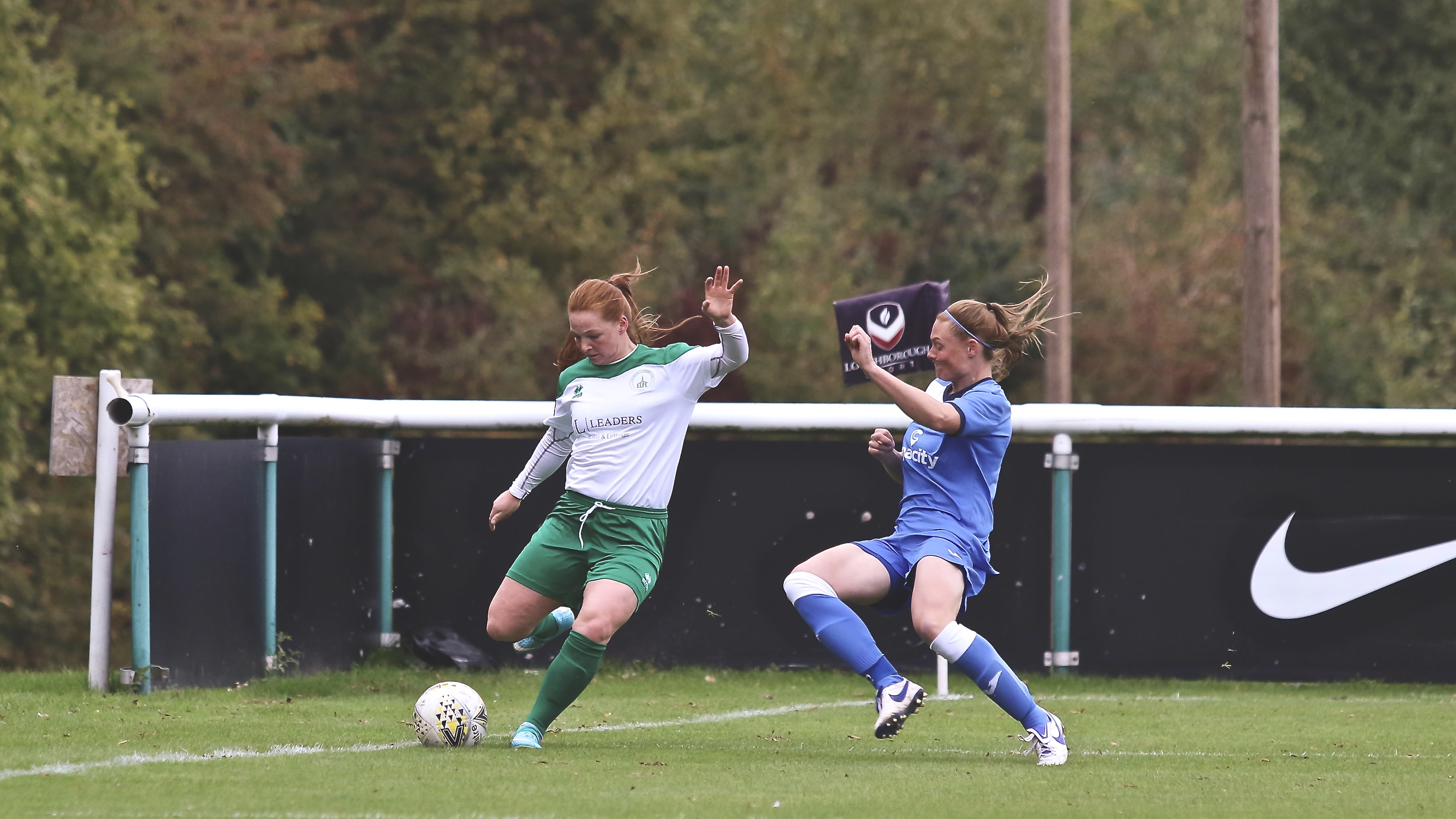 Jade Widdow puts on a cross as the Loughborough player goes in to block it.