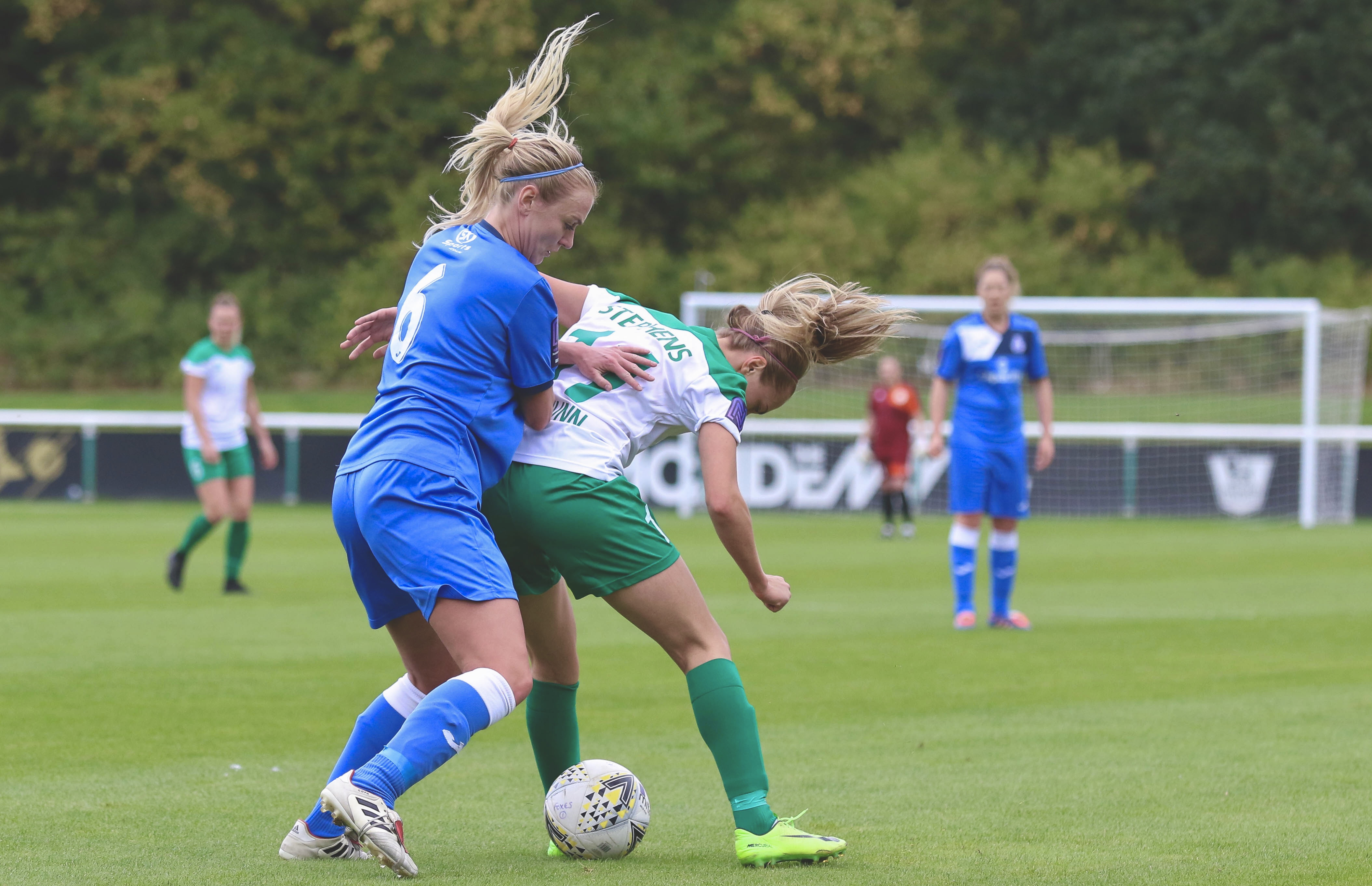 Chichester's Tash Stephens holds off the Loughborough player