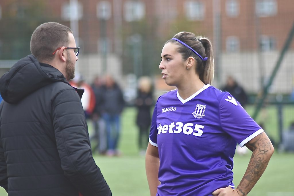 Faye McCoy talking with Stoke City Manager, Tim Dudding