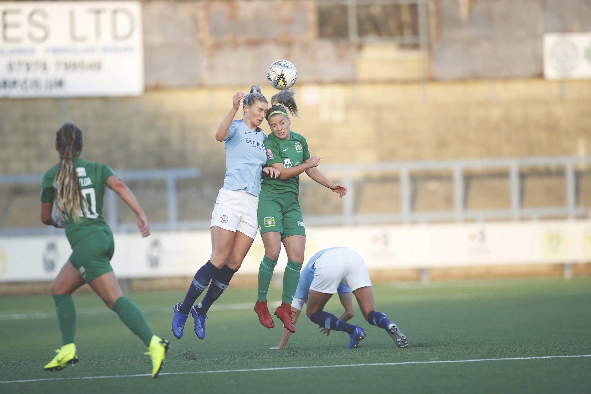 Liv Fergusson battles against the Man CIty Women's defence