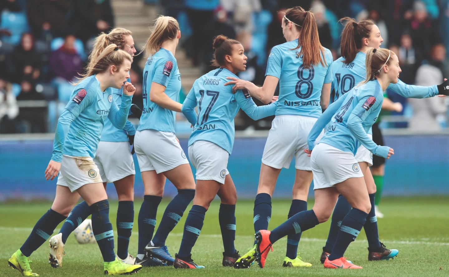 Nikita Parris of Manchester City Women centre celebrates with teammates after scoring