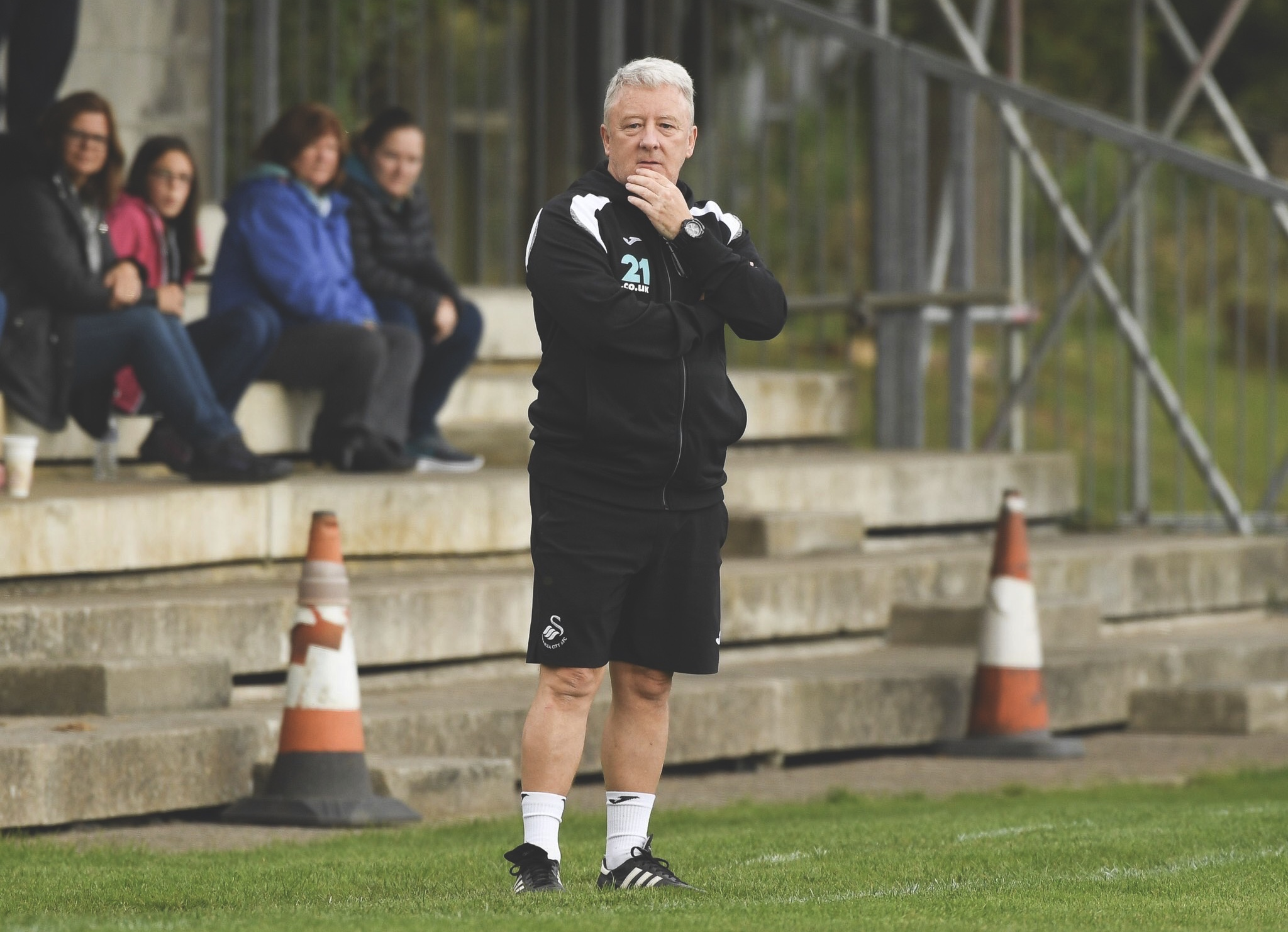 Swansea City's Ian Owen stood in the dugout. Photo by @SwanseaLadies