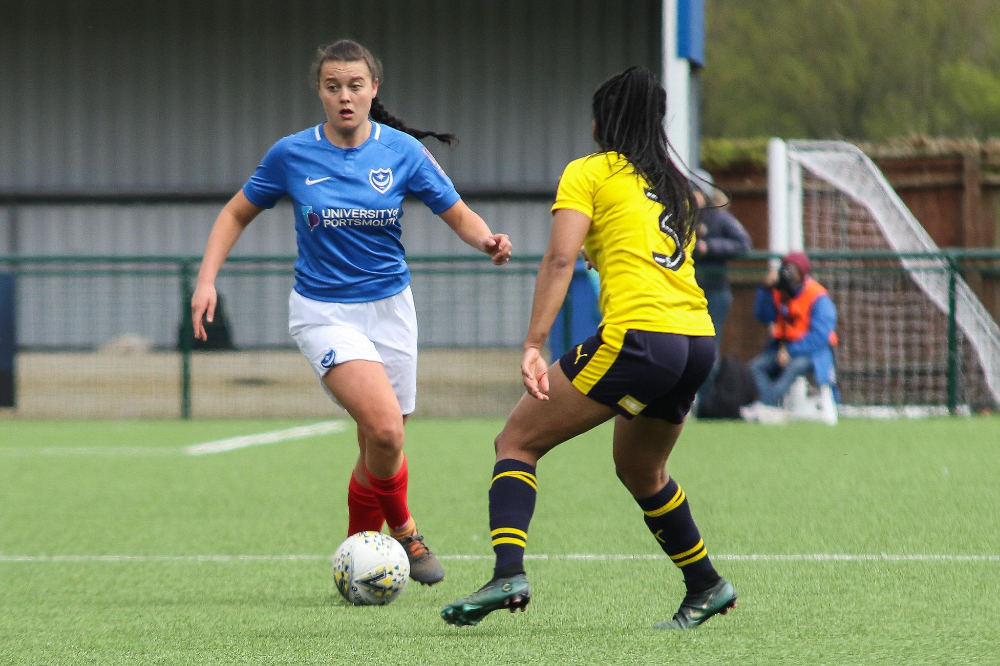 Jade Bradley taking on Oxford United. Photo by Jordan Hampton