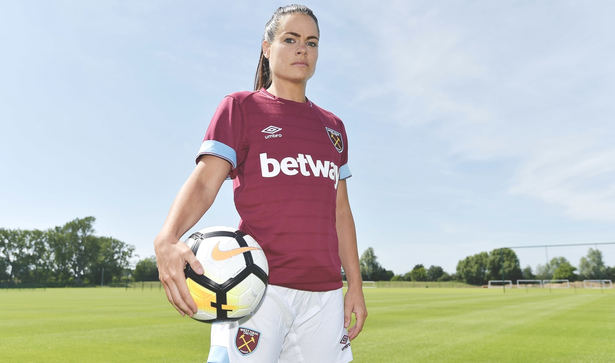 Claire Rafferty posing in her West Ham strip