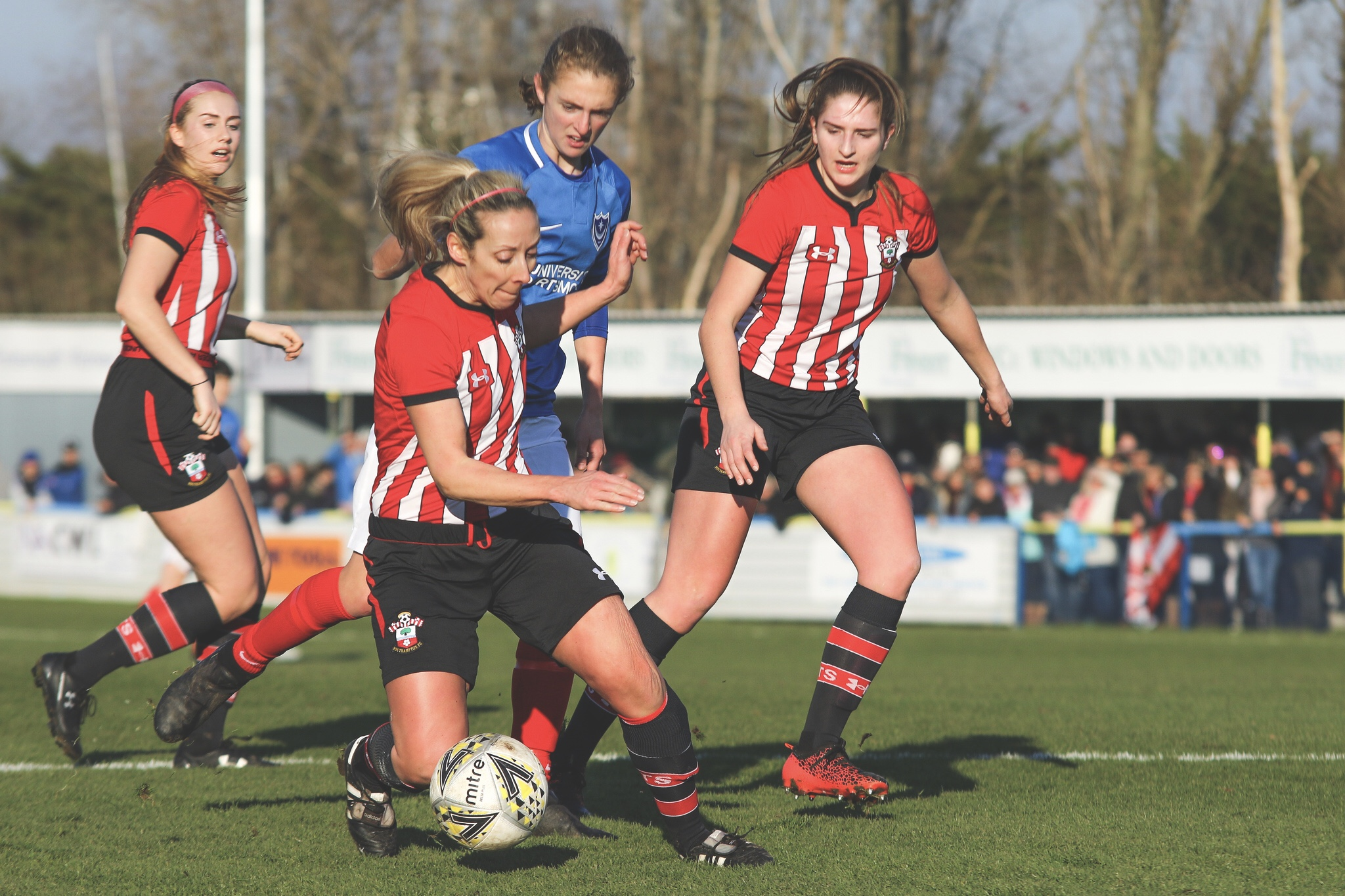 Shelly Provan shields the ball from Shannon Albuery. Photo by Jordan Hampton.