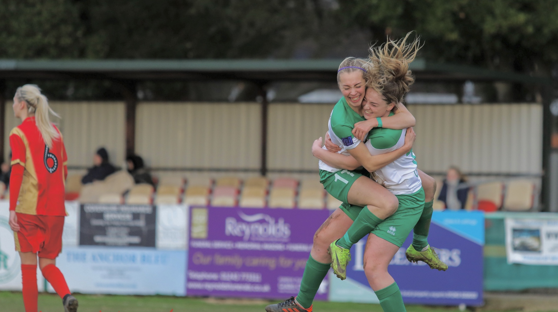 Tash Stephens and Sara Tubby celebrate during Chichester City versus MK Dons. Photo: Sheena Booker