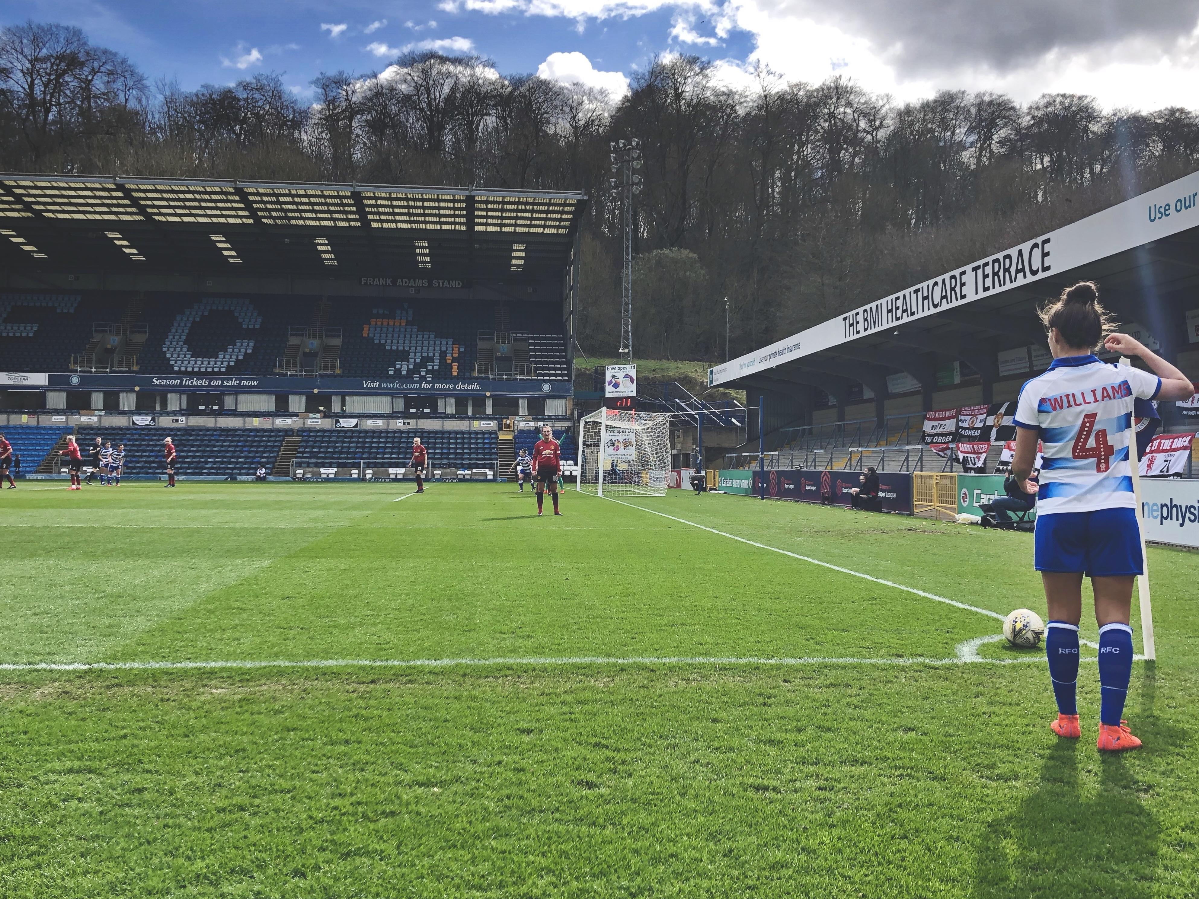 Reading's Fara Williams prepares to take a corner against Manchester United.