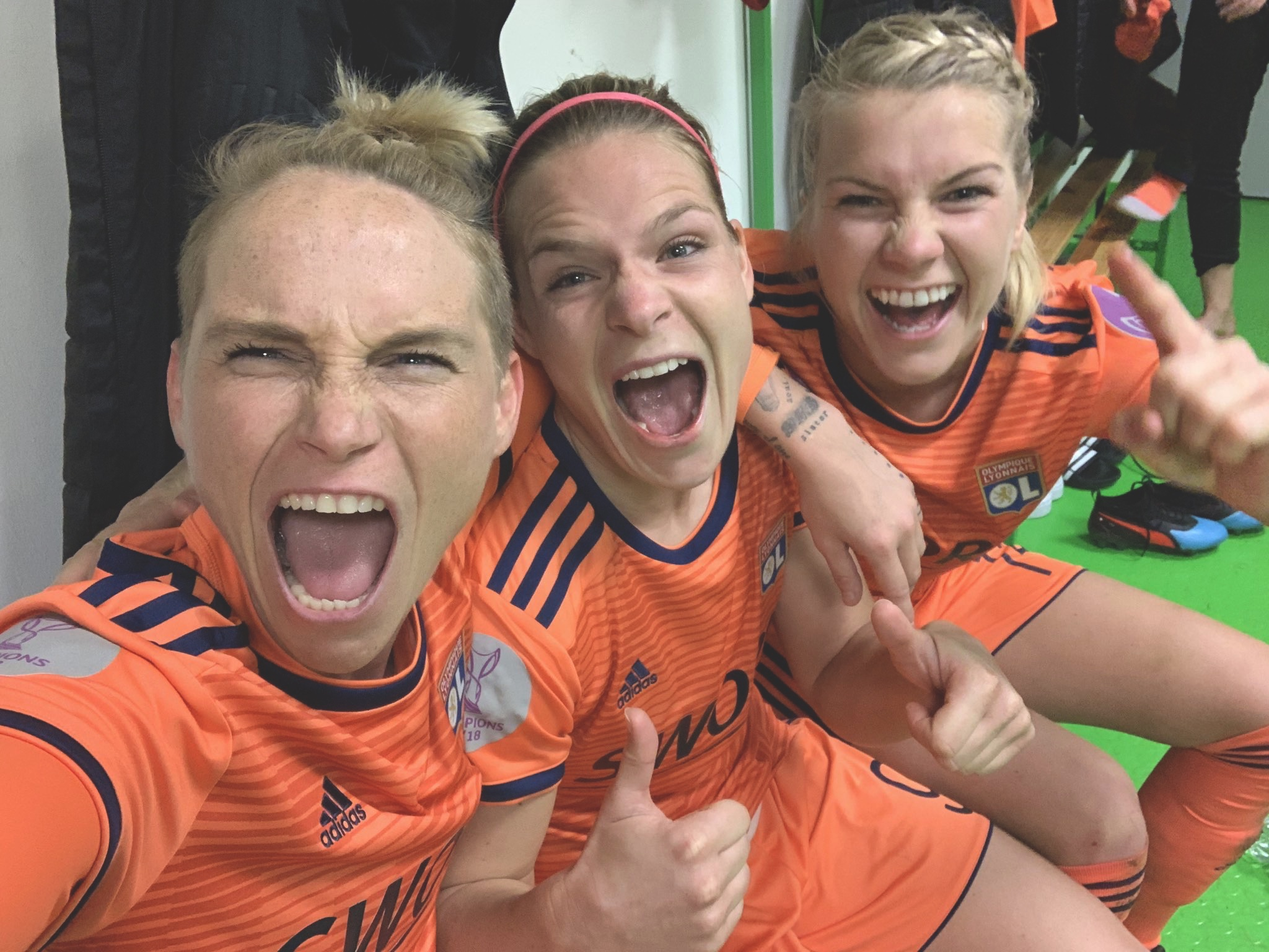 Jess Fishlock celebrates with her Lyon team mates after progressing in the UEFA Women's Champions League