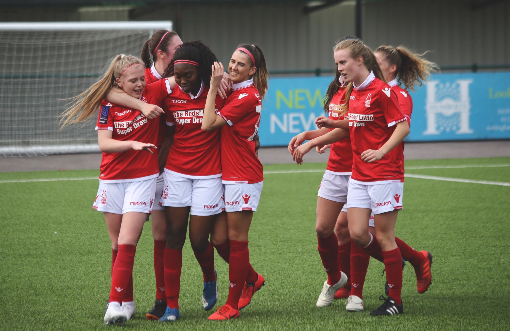 Precious Hamilton and her Forest team mates celebrate