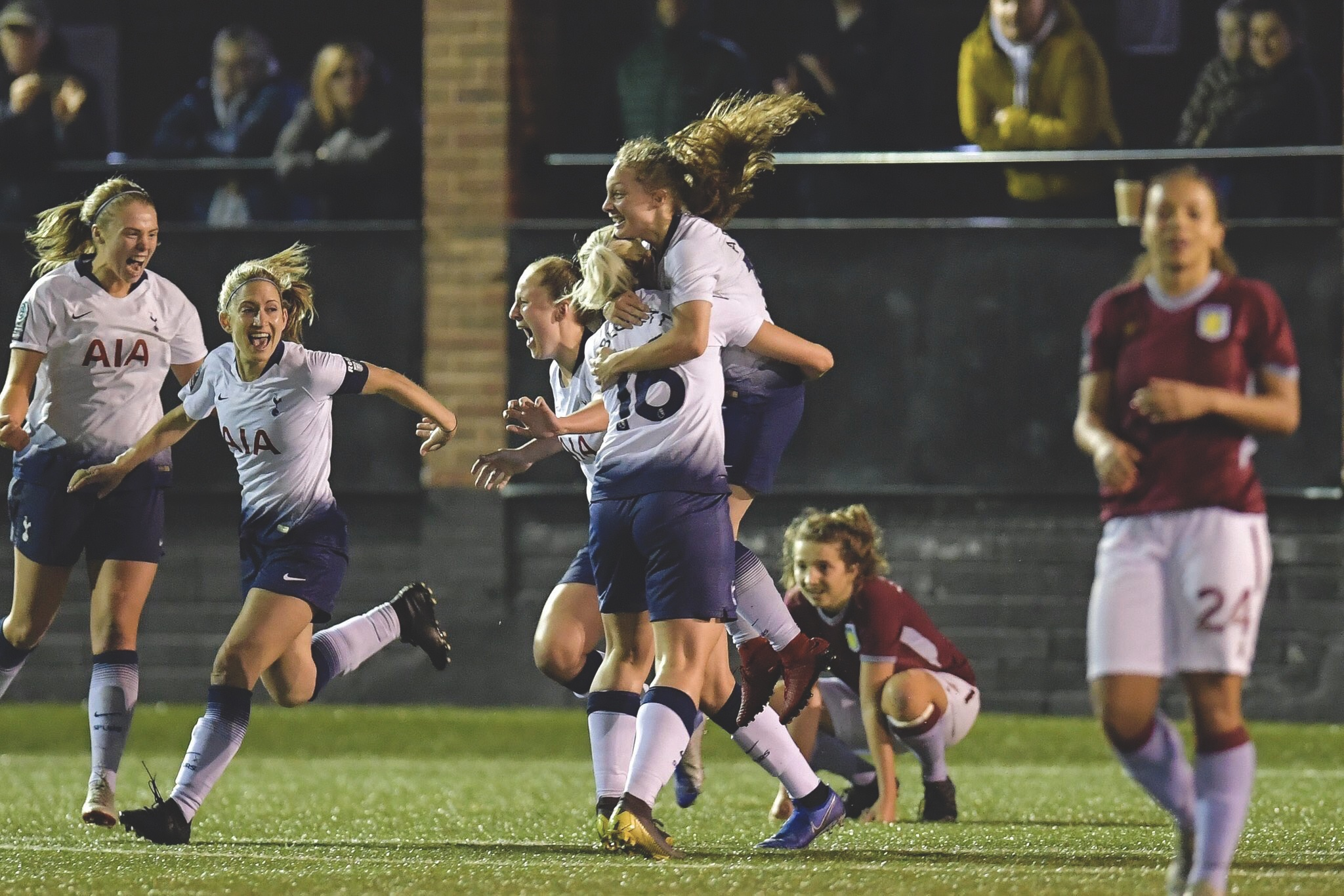 Tottenham Hotspur Women leap for joy at the final whistle.