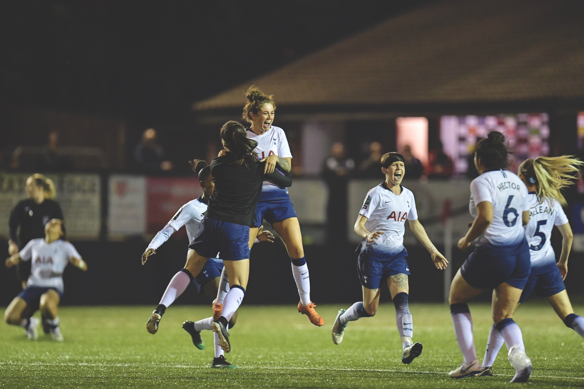 Tottenham Hotspur Women leap for joy at the final whistle and confirmation of promotion to the WSL